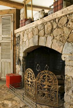 Salvaged-Wood Mantel.  Give your new fireplace a kick of green and some historical character by using salvaged materials. Reclaimed wood makes for a perfect mantel atop aged stone, and an antique hearth railing crowns the look.