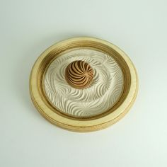 """9"""" Mini Zen Garden: Shallow Tray w/Large Sphere & Fine Sand. Create a zen space in your home with these rolling patterned balls and sand trays. Meditative and relaxing these small trays look great on the coffee table or as a tabletop conversation piece."""