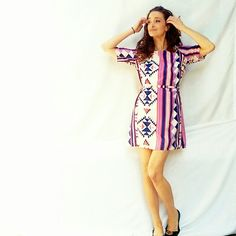 Hello Miss Tie-Back Boho Stripe Shift Dress- Small Hello Miss Tie-Back Boho Stripe Shift Dress- Size Small. Lightweight poly-blend, fully lined, zip-up funky shift dress with a matching belt that can be tied in the front, back or on the side for different looks. Striped with an Aztec/Native print. Perfect for transitioning from warm to cool weather and back again! New without Tags. Hello Miss Dresses
