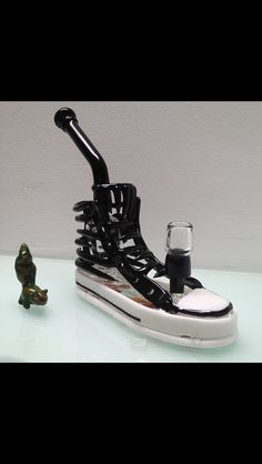 Hoobs glass Converse rig.  Fully functional.  1 of 2 all black and the one that sold belongs to Wiz Khalifa.