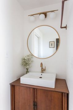 This shabby, unfinished cottage bathroom went from quick afterthought to beautifully renovated room.