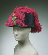 1914 Fur felt hat, trimmed with paste jewels and ostrich feathers. A femenized but definite military vibe.