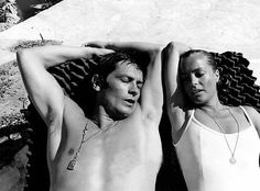 Romy Schneider and Alain Delon relaxing on the set of La Piscine.