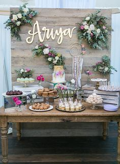 This whimsical feminine baby shower couldnt be prettier. From the ethereally draped tent to the incredible dessert display, this mama-to-be was showered in style.
