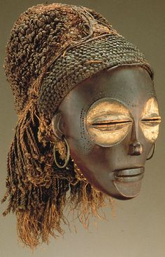 Female (Pwo) mask. Chokwe peoples (Democratic Republic of the Congo). Late 19th to early 20th century C.E. Wood, fiber, pigment, and metal. Higher resolution photo.