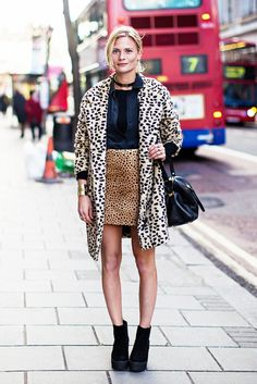 Cheetah print on top of cheetah print with a coat and mini skirt. // #StreetStyle