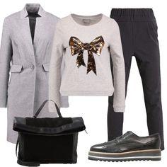 In questo outfit il protagonista è questo maglione con fiocco glitterrato abbinato a pantaloni neri, cappotto classico, stringate con zeppa e cappotto classico.
