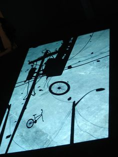 1st Light by Paul Chan is a projected piece of art on the floor of the ICA Boston. It is approximately 14 minutes long and using silhouettes depicts the end of the world and God's judgement of mankind.