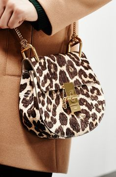 Fierce leopard spots lend saucy sophistication to a relaxed, modern Chloé saddle bag that is sure to amp up the street-style game.