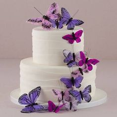 Make a butterfly wedding cake to remember with The Knot Shop's exquisite butterfly cake decorations, available in various colors. Purple Butterfly Cake, Butterfly Wedding Cake, Butterfly Birthday Party, Purple Wedding Cakes, Butterfly Cakes, Themed Wedding Cakes, Wedding Cake Toppers, Wedding Favors, Flower Cakes