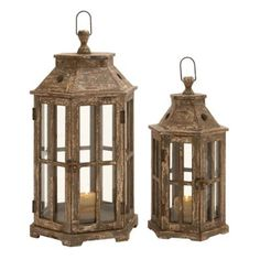Set the mood with the DecMode Hexagonal Lantern Candle Holder - Set of 2 . This pair of hexagonal fir wood lanterns features glass panes that allows. Lantern Set, Lantern Candle Holders, Candle Holder Set, Candle Lanterns, Glass Candle, Fall Lanterns, Halloween Lanterns, Metal Lanterns, Halloween Halloween