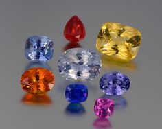 Sapphires fill the color wheel with endless possibilities. Clockwise from top: 5.66-carat natural pear-shape orange-red from Malawi, 25.51-carat fancy canary-yellow in a brilliant cushion cut, 10.08-carat violet-purple oval with lots of life, 4.03-carat purply pink one from Madagascar, 4.77-carat fine natural Sri Lankan blue, unusual 10.09-carat pumpkin orange, 11.5-carat pastel violet-blue. Center: 21.36-carat icy-blue oval brilliant-cut from Sri Lanka.