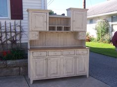 This is a new cupboard that we just made as a special order. Shown in Buttermilk over Tinderbox Brown.