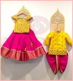 Beautiful yellow and pink color combination kids designer wear. Mugdha always love to design for your cute little once. They have a huge range of kids collection and they can customize the color and size as per your requirement. For orders whatsapp on . Indian Dresses For Kids, Kids Indian Wear, Kids Ethnic Wear, Dresses Kids Girl, Kids Outfits, Baby Dresses, Baby Boy Ethnic Wear, Indian Clothes, Indian Outfits