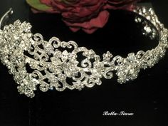 "FILIGREE FLORAL VINE SWAROVSKI CRYSTAL SIDE HEADBAND. GORGEOUS FLORAL PATTERN THROUGHT THE BAND. BAND ABOUT 1"" WIDE WITH 2 3/4"" SIDE PIECE."