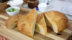 "This potato cheddar ""pierogi"" bread is perfect for sharing with guests since it can feed up to 20 people and is a European-inspired comfort food. It has potatoes, cheese, sour cream and green onions. Chef Recipes, Bread Recipes, Baking Recipes, Marilyn Denis Show Recipes, Burger Cookies, Ukrainian Recipes, Ukrainian Food, Brunch Casserole, Butter Tarts"