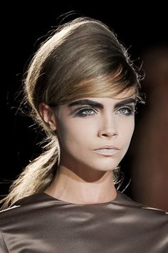 Bold Brows, Blocked out lips, Beautiful eyes and bouffant hair heart this !!