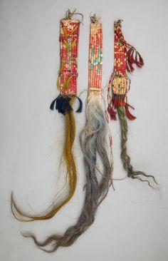 THREE SIOUX QUILLED HIDE HAIR DROPS.