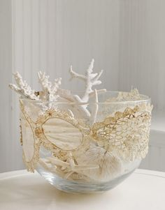 Decorate with Vintage Doilies - A Lace Doily Stretched Over a Bowl. BOWLED OVER Even when doilies are imperfect, their intricate finery shines through. Stitch little favorites end to end to create a band, then slip it tightly around a bowl. Clear glass lets light pass through the handiwork.