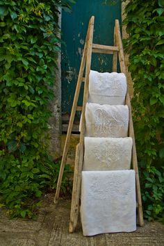 The old ladder holding linens. I have a smaller one in my kitchen =]