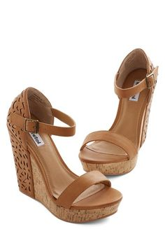 Above the Cut Wedge. These caramel platform wedges are anything but plain, and you excitedly slip them on before heading out on your blind date. #brown #weddingNaN