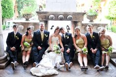 Bridal party with assorted hues of green with white vans for the bride, groom, and groomsmen | villasiena.cc