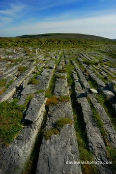 Clints and grikes in the Burren, Co, Clare, karts limestone landscape.  County Clare, Ireland.  The region measures approxiately 250 square kilometres and is enclosed roughly within the circle comprised by the villages Ballyvaughan, Kinvara Tubber, Corofin, Kilfenora dnd Lisdoonvarna, It is bounded  by the Atlantic and Galway Bay on the west and north.    There are a number of charted caves in the area.  Doolin is a populare base camp for cavers.