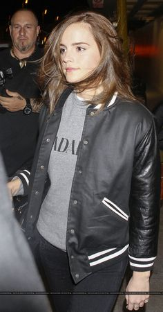 Emma Watson jetted in to LAX sporting a black and white jacket, black jeans  and f265315d37