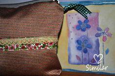 Estuche confeccionado en tela de tapiceria