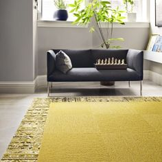 FLOR (carpet tile) | Made You Look F12BD FLORUG | Made You Look in Maize with a half-tile border of Reoriented in Chartreuse.