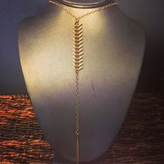 Spear Necklace - This awesome fishtail and spear necklace is a perfect addition to your spring wardrobe. Also available in silver. - $42.00