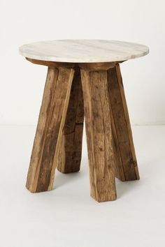 This would make a lovely plant stand on the porch.  Or end table in a rustic living area.