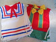 Mochilas feitas em tecido algodão <br>com detalhes em fitas de cetim e vies <br>Seus convidados vão adorar !! <br> OBS: Este valor é a unidade. <br>Pedido minimo 10 unidades