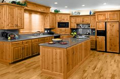 There are some parts in the pine kitchen cabinets which are used for new design in the kitchen furniture. The pine kitchen cabinet is made from Repainting Kitchen Cabinets, Hickory Kitchen Cabinets, Two Tone Kitchen Cabinets, Kitchen Cabinets Pictures, Kitchen Cabinet Styles, Kitchen Cabinetry, Pine Cabinets, Corner Cabinets, Glass Cabinets