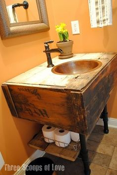Old Salvaged Wall Cabinet...re-purposed into a fabulous rustic bathroom vanity with the addition of plumbing pipe for the legs & storage shelf!!   LOVE this! by c.g.