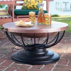 This copper fire pit converts from a fire bowl to a fire pit table with the addition of the matching lid. Hammered copper fire pit is a four season favorite. Fire Pit With Lid, Copper Fire Pit, Copper Wood, Wood Burning Fire Pit, Hammered Copper, Round Patio Table, A Table, Fire Pit Ring, Fire Pits