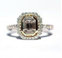 Specialty cut Baguettes surround an Emerald Cut centre Diamond, encased in 18WYG #DiamondsExclusive