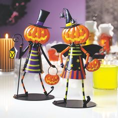 Dancing Pumpkin Votive Holders, Jack and Jill. A tealight or votive candle lights up their happy grins.