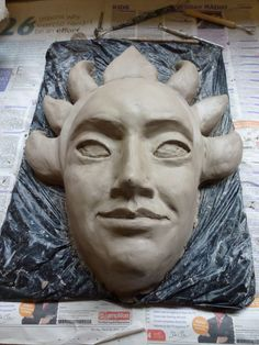 Starting a new mask sculpt in clay. Some kind of sun deity?