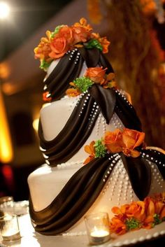 Orange and brown wedding cake with chocolate swags
