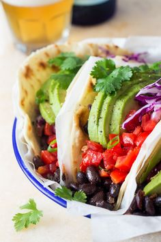 Vegan black bean tacos are easy and satisfying to make. They& full of flavour and texture and will keep you satiated for hours. Cake Simple, Lazy Cat Kitchen, Fried Beans, Black Bean Tacos, Spicy Salsa, Plant Based Recipes, Dinner Recipes, Lunch Recipes, Salad Recipes