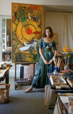 Ivy Nicholson wearing dress by Claire McCardell is standing in front of Marc Chagall's painting Le Soleil Rouge in his studio in Vence, photo by Mark Shaw, 1955 | Flickr - Photo Sharing!
