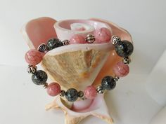 Check out this item in my Etsy shop https://www.etsy.com/listing/480457309/pink-gray-beaded-bracelet-handmade