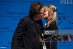 Musician Tom Waits kisses his wife and song writing parter Kathleen Brennan after receiving the PEN New England Song Lyrics of Literary Excellence Award ceremony at the John F. Kennedy Presidential Library and Museum in Boston on Sept. 19, 2016.