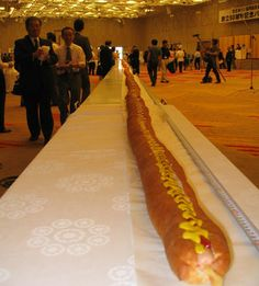 This is a photo of the current world's longest hot dog which measures in at 60.3m in length and the world record was made at the Akasaka Prince Hotel in Tokyo in 2006. This world record was certified by Guinness.