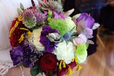 """Bohemian Chic inspired bridal bouquet created by """"WOW"""" Event Design & Coordination. Consists of white peonies, purple lisanthius, red baby roses, succulents, thistle, trick moss, spider mums, and hypericum! #bohemianchicbouquets #bridalbouquets #bohemianchicweddings #bohemian #wedding #succulentbouquets #texturedbouquets"""