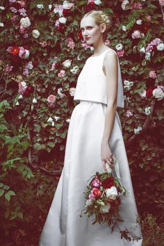 Our two-piece bridal look is a breathtaking choice and beautiful alternative to a traditional wedding gown. The Astrid features a sleeveless crop top with a swingy open-back cut and a high-waisted maxi skirt rendered in lustrous silk faille. Concealed back zipper with hook-and-eye closure. Made in NYC.This look is part of an exclusive collaboration with Stone Fox Bride. All dresses are made to order and are available in standard sizing.For assistance with placing your order, please contact…