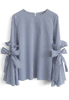Gotta earn your stripes, babe, and there's no better way to own them than this dramatic Charisma top with bell sleeves, ruffles and self-tie bows. - Bell Sleeves with Self-tie bowknot and ruffles - Spilt cuffs - Concealed back zip closure - Not lined - 100% Polyester - Hand wash Size(cm)Length Bust Shoulder Sleeves XS/S 61 90 37 ...