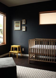 Think out of the box when decorating a child's bedroom or nursery. Allow black to act as a backdrop for colourful accessories, wood features, or crisp white trim. Natural light from the windows reflects on the dark walls and warms up the room. Dark Nursery, Nursery Room, Baby Room, Nursery Modern, Kids Bedroom, Nursery Decor, Elephant Nursery, Nursery Neutral, Bedroom Decor