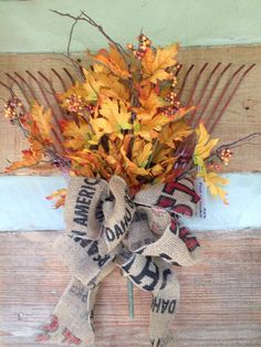 This old leaf rake arrangement would look great on the farm house door!
